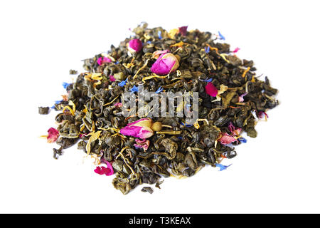 Heap of aromatic dry green tea  with cornflower and small dry buds of roses isolated on white background - Stock Photo