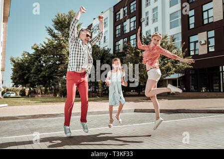 Joyful happy nice family having fun together - Stock Photo