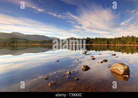 Loch Morlich and Cairngorm Mountains, Cairngorms National Park near Aviemore, Badenoch and Strathspey, Scotland, UK - Stock Photo