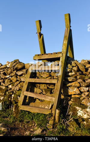 A Ladder stiles crossing a dry stone wall in Derbyshire,UK. - Stock Photo
