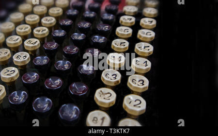 Close up on the keyboard of an antique Comptometer. Low key, copy-space. - Stock Photo