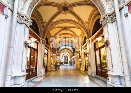 Ornate interior of the Freyung Passage shopping arcade in downtown Vienna, Austria. - Stock Photo