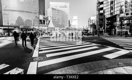 Tokyo, Japan - January 1, 2010: Pedestrians crossing the street at the heart of Ginza District in Tokyo. Ginza crossing by day. - Stock Photo