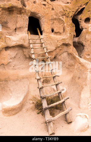BANDELIER NATIONAL MONUMENT , NEW MEXICO / UNITED STATES - NOVEMBER 15, 2015: A ladder leads into a cave in an Ancestral Puebloan site of Bandelier Na - Stock Photo