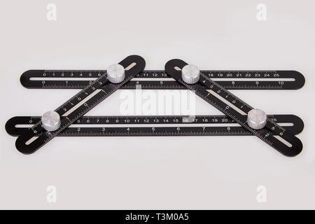 Black multi function Ruler isolated on white background. Ultimate Irregular Shape Copy Tool. Universal Easy Angle Ruler. Multi Angle Measuring Tool. - Stock Photo