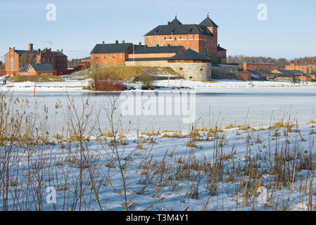 The old fortress-prison on the shores of Vanajavesi lake on a March afternoon. Hameenlinna, Finland - Stock Photo