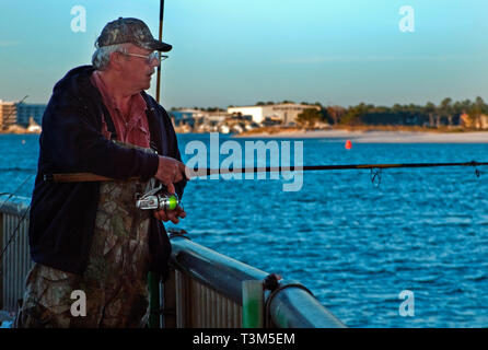 A man fishes at Florida Point, Nov. 12, 2009, in Orange Beach, Alabama. - Stock Photo