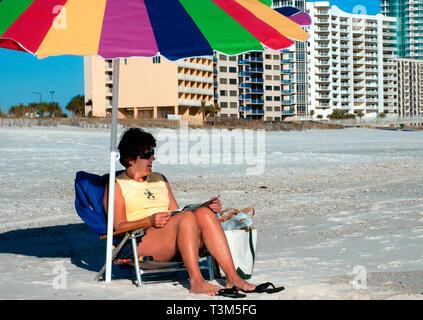 A woman reads at Gulf State Park, Nov. 12, 2009, in Orange Beach, Alabama. - Stock Photo