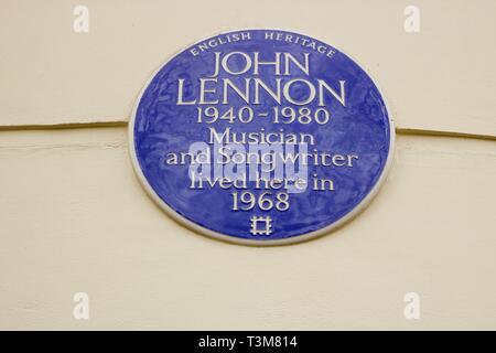 English Heritage blue plaque indicating the former home of John Lennon member of The Beatles pop group - Stock Photo