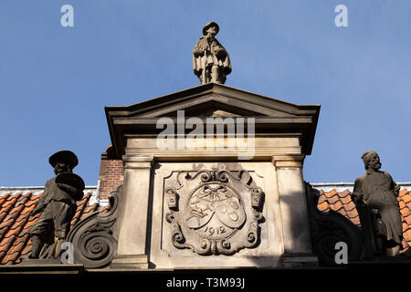 Sculpted figures in Haarlem, the Netherlands. The figure is on the roof of the Frans Hals Museum. - Stock Photo