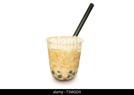 Pearl milk iced tea with straw and cream isolated in white background. - Stock Photo