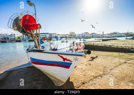 Fisherman's boat docked in the city centre of Tavira, Algarve, Portugal - Stock Photo