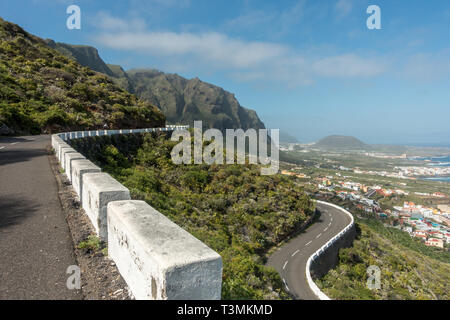A road biker enjoying the hairpin bends of the cliff side road out of Garacchico on the north side of Tenerife. - Stock Photo
