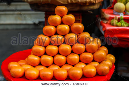 A background of fresh oranges on a market - Stock Photo