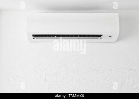 Cool air conditioner on white modern interior room cooling comfortable fresh system - Stock Photo