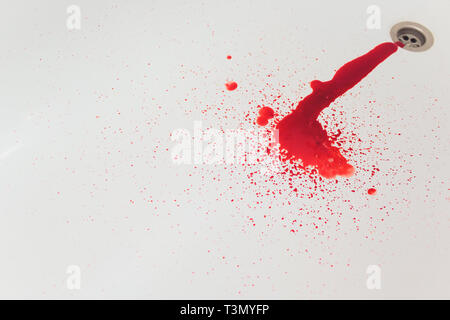 Splashes of blood dripping into the sink in the bathroom - Stock Photo