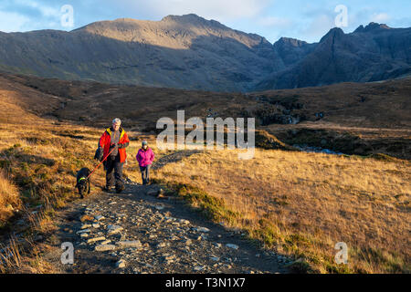 Footpath leading to and from the Fairy Pools with the Cuillin Hills in the background, Isle of Skye, Highland Region, Scotland, UK - Stock Photo