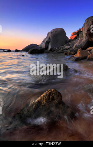 The amazing wind carved rocky sculptures at the beach of Cala Spinosa,a beautiful small bay surrounded by huge granite rocks at Capo Testa in the nort - Stock Photo