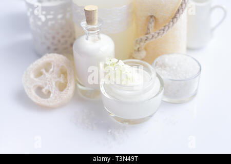 Spa composition with candles, cream, salt and flowers of hydrangea on a white background - Stock Photo