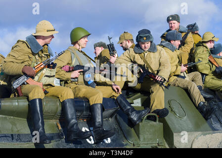 SAINT-PETERSBURG, RUSSIA - FEBRUARY 17, 2019: Soviet soldiers on the armor of an armored personnel carrier. Fragment of the military-historical festiv - Stock Photo