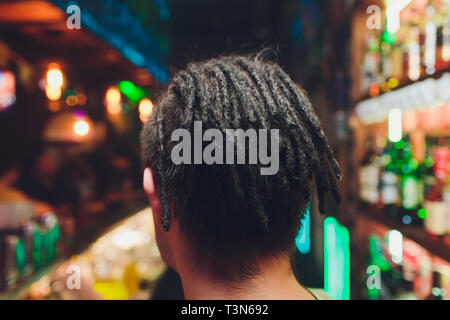 male african mohawk pigtails cornrows mans braids - Stock Photo