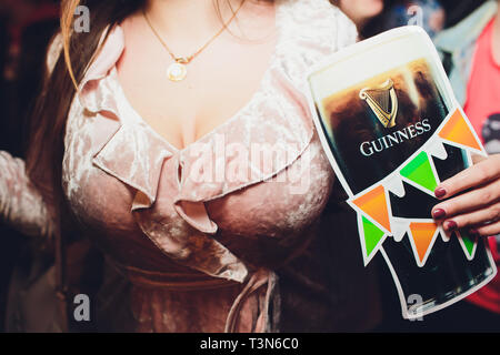 Ufa, Russia, HARAT'S PUB, 15 November, 2018: Guinness beer Guinness beer bottle cap in bubbles - Stock Photo