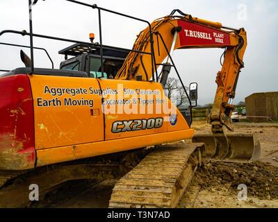 A Case CX210B JCB excavator at  a job on a farm - Stock Photo
