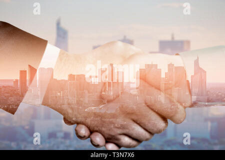 Close up business handshake with global multi-exposure and cityscape - Stock Photo