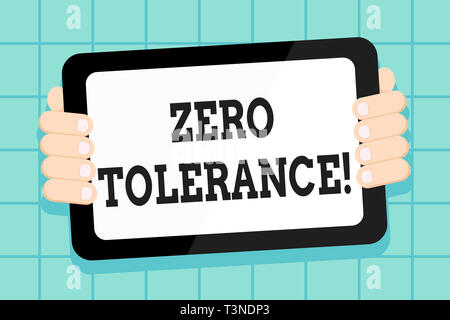 Conceptual hand writing showing Zero Tolerance. Concept meaning refusal accept antisocial behaviour typically by strict Color Tablet Smartphone with S - Stock Photo