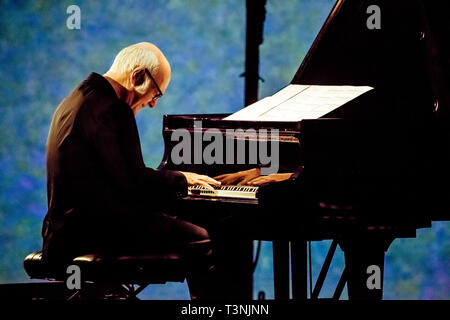 Parma, Italy. 10th Apr, 2019. After the success of the 'ensemble' concert in the 2015 edition, Ludovico Einaudi, famous Italian composer and pianist, Wednesday 10 April 2019 at 9.00 pm returns to the Teatro Regio di Parma with his new international tour, starting in March. Ludovico Einaudi, born in Turin in 1955, is an Italian composer and pianist known and appreciated throughout the world for his concerts, his famous soundtracks and his recording career. Credit: Luigi Rizzo/Pacific Press/Alamy Live News - Stock Photo