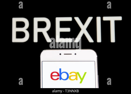 Hong Kong. 6th Apr, 2019. In this photo illustration a American multinational e-commerce online auction and shopping company Ebay logo is seen on an Android mobile device with a Brexit message in the background. Credit: Budrul Chukrut/SOPA Images/ZUMA Wire/Alamy Live News - Stock Photo