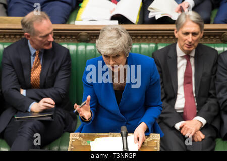London, Britain. 10th Apr, 2019. British Prime Minister Theresa May (C) attends the Prime Minister's Questions at the House of Commons in London, Britain, on April 10, 2019. Leaders of the European Union's remaining 27 member countries have agreed to an extension of Brexit, European Council President Donald Tusk said on Twitter Wednesday night. Credit: UK Parliament/Mark Duffy/Xinhua/Alamy Live News - Stock Photo