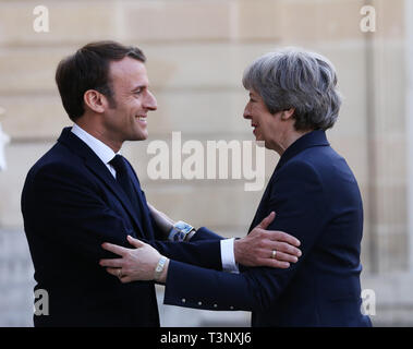 Beijing, France. 9th Apr, 2019. French President Emmanuel Macron (L) welcomes visiting British Prime Minister Theresa May at the Elysee Palace in Paris, France, April 9, 2019. Credit: Gao Jing/Xinhua/Alamy Live News - Stock Photo