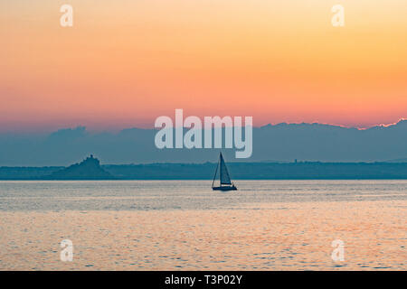 Newlyn, Cornwall, UK. 11th Apr, 2019. UK Weather. A chilly but glorious start to the day at Newlyn at sunrise, as this yacht makes for the harbour at Newlyn. Credit: Simon Maycock/Alamy Live News - Stock Photo