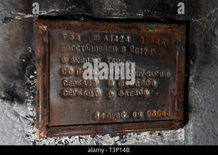 Novosibirsk, Russia. 11th Apr, 2019. NOVOSIBIRSK, RUSSIA - APRIL 11, 2019: A memorial plaque on a T-34 battle tank prepared to open a military parade in Novosibirsk on May 9 and mark the 74th anniversary of the Soviet victory over Nazi Germany in World War II. The author of a project to restore T-34, tank mechanic Andrei Shuvarin dedicated his work to his grandfather who fought to liberate Ukraine, Donbass, and in the 1945 Battle of Berlin. Kirill Kukhmar/TASS Credit: ITAR-TASS News Agency/Alamy Live News - Stock Photo