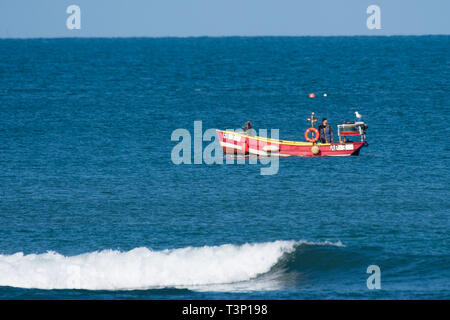 Aberystwyth Wales, UK. 11th Apr, 2019. UK Weather: Local inshore lobster fisherman out in his small boat on the calm sea on a gloriously bright and sunny morning in Aberystwyth on the Cardigan Bay coast of west Wales.
