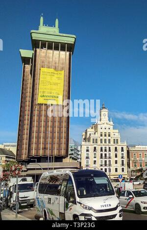 View of a huge banner placed by environmental group Greenpeace's activists on the facade of Torre de Colon tower denouncing the 'inaction' by Spanish politicians and companies with regard to environment, in downtown Madrid, Spain, 11 April 2019. Several Greenpeace's climbers have put a 300-square meters long banner simulating the 'billing cost' of the general election to demand the political parties that they do not forget the environmental issues during election campaign. Spanish general election will be held on next 28 April. The banner reads '2019 general election. Proforma invoice 04/28/19 - Stock Photo