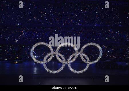(190411) -- BEIJING, April 11, 2019 (Xinhua) -- Photo taken on Aug. 8, 2008 shows the shining Olympic rings on a huge LED screen, proclaiming the arrival of the Olympiad, during the opening ceremony of the Beijing 2008 Olympic Games in the National Stadium, or the Bird's Nest, Beijing, capital of China. From sending athletes to Helsinki Summer Olympic Games for the very first time in 1952 to winning the bid to host 2022 Winter Olympic Games in 2015, the People's Republic of China went through a remarkable history of sports,  including successfully hosting the 2008 Summer Olympic Games and prep - Stock Photo
