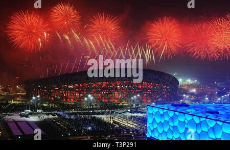 (190411) -- BEIJING, April 11, 2019 (Xinhua) -- File photo taken on August 8, 2008 shows the fireworks displayed during the opening ceremony of the Beijing Olympic Games held in the National Stadium, also known as the Bird's Nest, in Beijing, capital of China. From sending athletes to Helsinki Summer Olympic Games for the very first time in 1952 to winning the bid to host 2022 Winter Olympic Games in 2015, the People's Republic of China went through a remarkable history of sports, including successfully hosting the 2008 Summer Olympic Games and preparing for the upcoming 2022 Winter Olympic G - Stock Photo