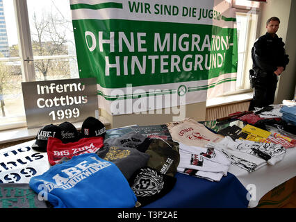 Potsdam, Germany. 11th Apr, 2019. Findings found during searches against a right-wing extremist network in Cottbus lie on a table in the Ministry of the Interior. After the large-scale raid against right-wing extremist networks in Brandenburg and other East German states, 16 people are suspected of having formed a criminal organization. Credit: Bernd Settnik/dpa-Zentralbild/dpa/Alamy Live News - Stock Photo