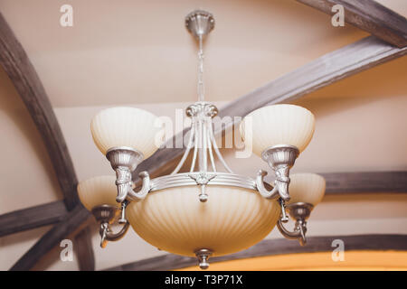 Close-up of a beautiful crystal chandelier Beautiful chandelier. luxury expensive chandelier hanging under ceiling - Stock Photo