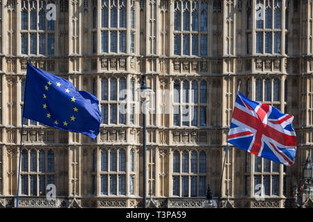 On the day that Prime Minister Theresa May returns to Brussels to negotiate an expected Brexit delay, the EU flag and Union jack fly as pro-EU remainers protest opposite parliament in Westminster, in London, England. - Stock Photo