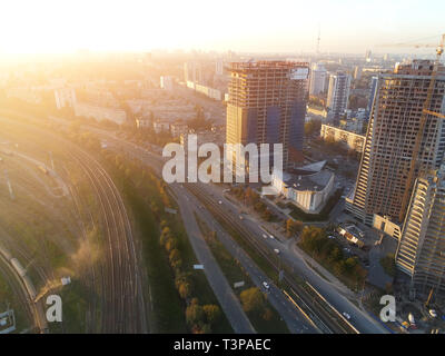 Haze lying over metropolis city with big railroad junction and roads. Smoke and mist covering buildings at skyline. Evening natural flare. Beautiful - Stock Photo
