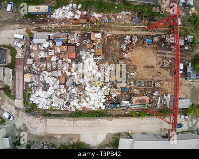Scrap metal junkyard area aerial view. Reception and storage metal waste before recyclyng - Stock Photo