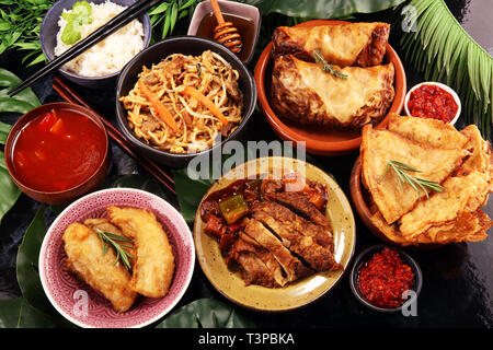 Assorted Chinese food set. Chinese noodles, fried rice, peking duck, dim sum, spring rolls. Famous Chinese cuisine dishes on table. Chinese restaurant - Stock Photo