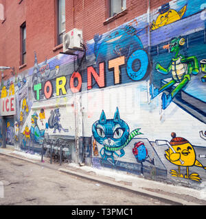 Brilliant urban art and murals on Graffiti Alley (Rush Lane), in the Queen Street West district of Toronto, Ontario, Canada. - Stock Photo