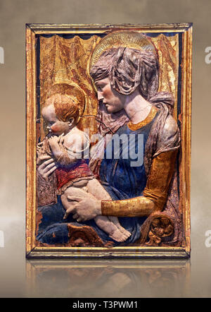 Painted terracotta relief panel depicting the Virgin and Child by Niccolo Bardi better known as Donatello. Made in Florence around 1386. Inv RF 353, T - Stock Photo