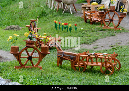wooden cart and horse in a public park - Stock Photo