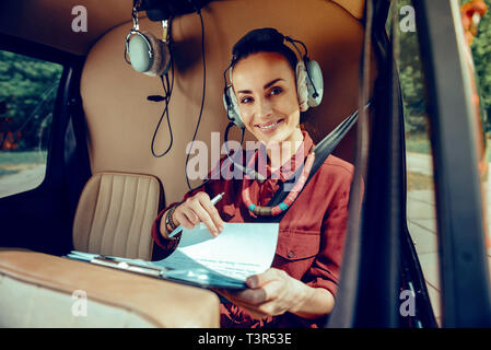 What is the value of a Postal mail Order Bride Price? smiling appealing lady in red shirt checking her papers during flight t3r53e