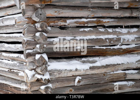 The snow covered corner joint of a traditional log cabin in Finland. - Stock Photo